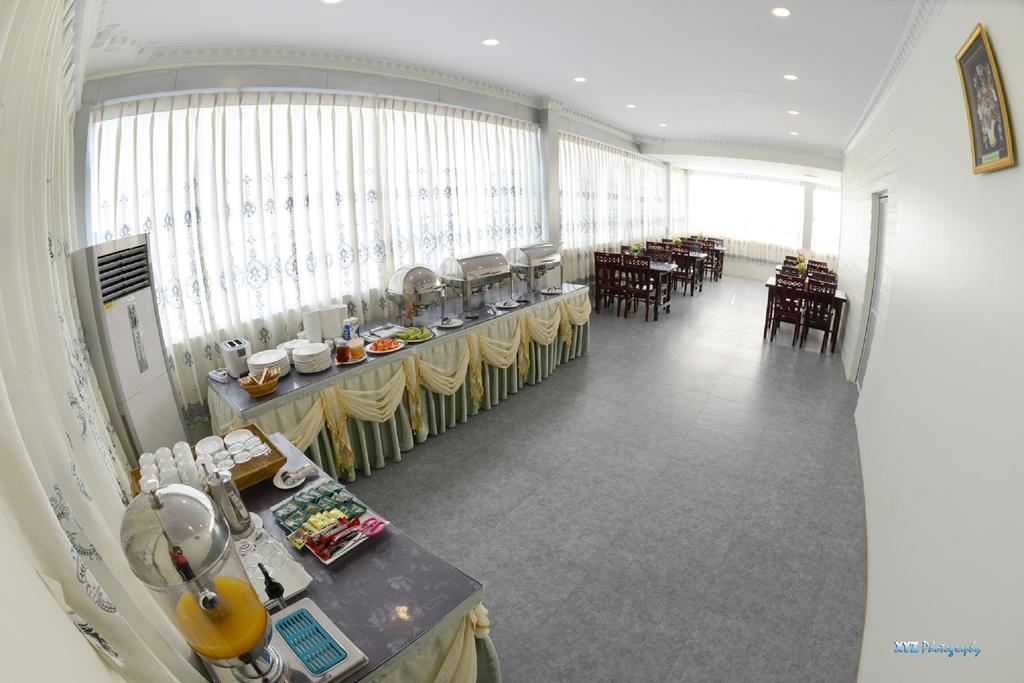 4731f-hotel-my-world-mdl-dinning-room.jpg