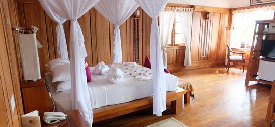 3394d-Myanmar-Treasure-Resort-Bedroom-Inle-Lake.jpg